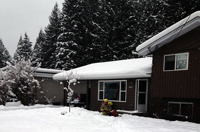 Revelstoke Fire Rescue Service personnel at the second fire this past week, this time on Pearkes Drive. Photo courtesy of the Revelstoke Fire Rescue Service