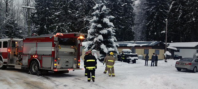 Firefighters scramble to deal with the second fire on Lundell Road in the big Eddy on Friday, December 13. This was the also the third of three fires in just seven days. Fire Chief Rob Girard is warning everyone in town to be extra-careful this Christmas. Photo courtesy of Revelstoke Fire Rescue Service
