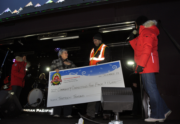 """It takes a very rare and very special occasion for Patti Larson to be struck genuinely speechless. But that's what happened when the CPR's mark Jackson handed here this over-sized cheque for $13,000 — more than three times what the Community Connections Food Bank normally receives. """"I couldn't believe it,"""" she said later. """"I just didn't know what to say."""" After a couple of false starts, though, Patti managed some very profuse than yous. David F. Rooney photo"""