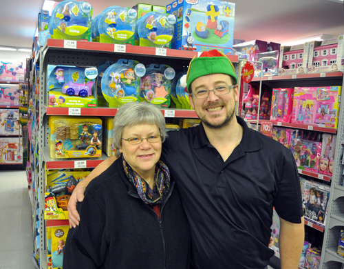 """Red Apple Manager Trevor English was truly an emissary from Santa's Workshop at the North Pole when he presented Patti Larson with $1,400 worth of new toys for the Christmas Hamper Program. """"No child should go without a present at Christmas,"""" he said. The Christmas Hamper Program wraps up on Monday, December 23, so be sure and hurry down if you have a donation you'd like to make. David F. Rooney photo"""