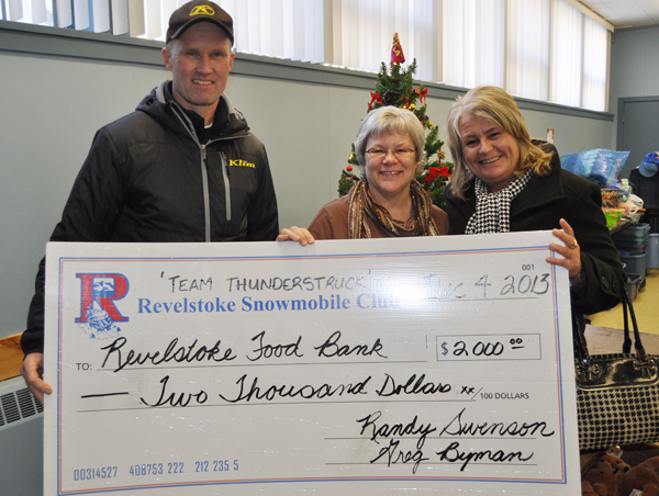 Community Connections Food Bank Coordinator Patti Larson was all smiles on Wednesday and well she should have been. Greg Byman and Kathy Burke of the Revelstoke Snowmobile Club dropped by with a cheque for $2,000 raised at the club's recent fund-raising banquet at the Hillcrest Hotel, which was attended by a  couple of hundred members. And that's not all. The club also dropped off another $155 in donations and 150 pounds of food. That'sa an excellent start to Christmas season! David F. Rooney photo