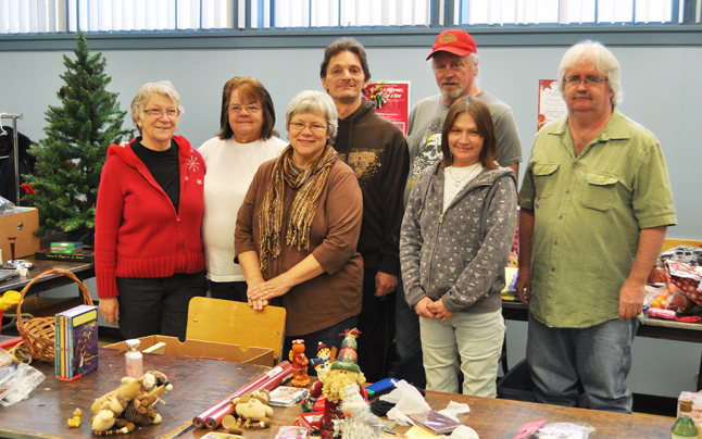 Community Connections Food Bank Coordinator Patti Larson (center) and the volunteers who worked tirelessly to ensure that this year's Christmas Hamper depot was a successful one — and it was. About 185 hampers were distributed to needy individuals, children and families. Hampers contained turkeys or hams, toys, warm articles of clothing, basic foodstuffs and personal grooming items. David F. Rooney photo