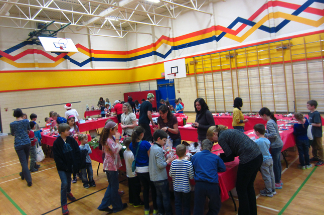 Here's an overview of students having fun at the annual fair on December 13 in the AHE gym. Todd Hicks photo, Amelia Brown and Alice Dunkerson caption