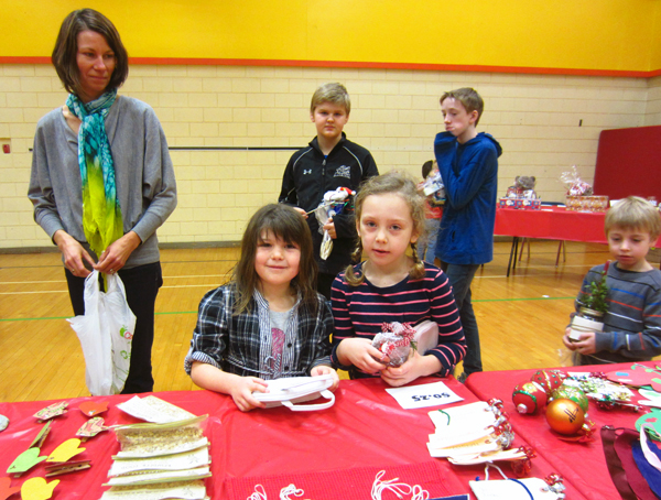 Abby Maloney and Mackenzie Roe show off their purchases at the craft fair in the AHE gym on December 13. Todd Hicks photo, Amelia Brown and Alice Dunkerson caption
