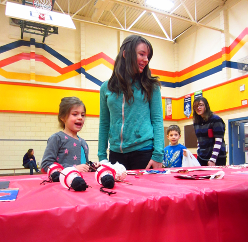 Suri Stewardson and Kimberly Howard shop for gifts at the craft fair on December 13 in the AHE gym. Todd Hicks photo, Alice Dunkerson and Amelia Brown caption