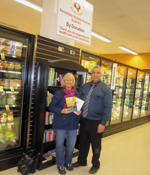 Sharon Cain of the Revelstoke Hospital Auxiliary poses with Joe Mele who built this lovely book kiosk for the society and installed it in Cooper's for the convenience of the store's book-reading clientel. Donations from people who pick up a book or two go to support the Auxiliary's fund-raising in support of local health-care initiatives. Way to go, Joe! Photo courtesy of the Revelstoke Hospital Auxiliary