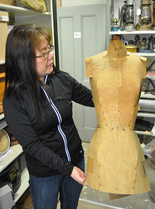 Harumi examines the dress maker's form. Every portion of the form was adjustable so that the different fabric portions of a dress or blouse could be fitted to it.  David F. Rooney photo