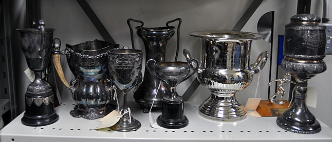 Tarnished by time these silver-plated trophies from bygone sports events could probably tell a few sports field tales.  David F. Rooney photo