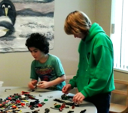 Esteban Awad gets a little help from Simon Blackie during Saturday's Lego event at the Revelstoke branch of the Okanogan Regional Library. Lucie Bergeron photo
