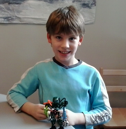 Kristian Madsen shows off his Lego creation, which he called The Smasher. Lucie Bergeron photo