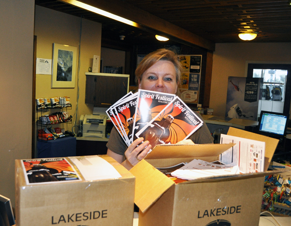 Emma Kirkland took delivery of thousands of Spirit Fest brochures Friday. Brochures are available at locations all over the city. David F. Rooney photo