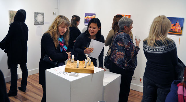 Luci Bergeron and Kendra Runnalls were quite taken with Mas Matsushita's cribbage board. David F. Rooney photo