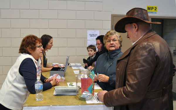 George and Bjorg Buhler (right) purchase food tickets for the Revelstoke Multicultural Society's Carouself of Nations, which was one of the highlights of the 2014 Spirit Festival. David F. Rooney photo