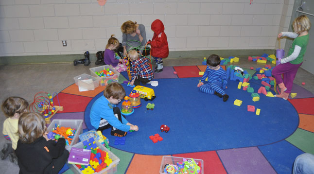 ... kids who needed a little more space for play had ne corner of the Community Centre's Multi-Purpose Room all to themselves with plenty of blocks and other toys. David F. Rooney photo
