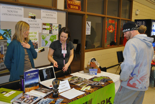 Megan Shandro (left) and Meghan MacIsaac talk with a curious passerby about the Stoke Youth Network.  David F. Rooney photo