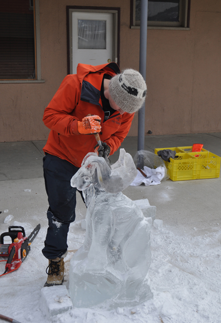Highly focused ice carver Kegan Podolas chips away at his piece de resistance a metre-high big horn sheep. The carver, who did his thing in from of The Cabin, attracted an intermmintant crowd on a chilly Sunday morning. David F, Rooney photo