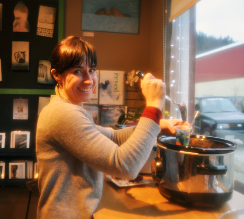 Krista Cadieux serves up some chili at the Sangha Bean. $5 got you a passport allowing you to taste chili all over town. David F, Rooney photo