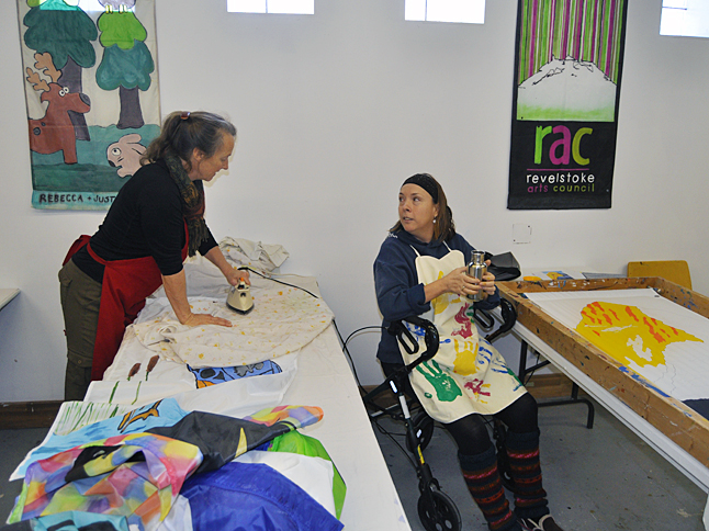 Pauline Hunt (right) takes a break from painting her banner to chat with Jackie James at the Visual Arts Centre. Jackie, who coordinates the Banner Program with Tina Lindegaard, said 70 people have created banners this year. There's still room for more. You can register for the program by calling the Community Centre at 250-837-9351. David F. Rooney photo