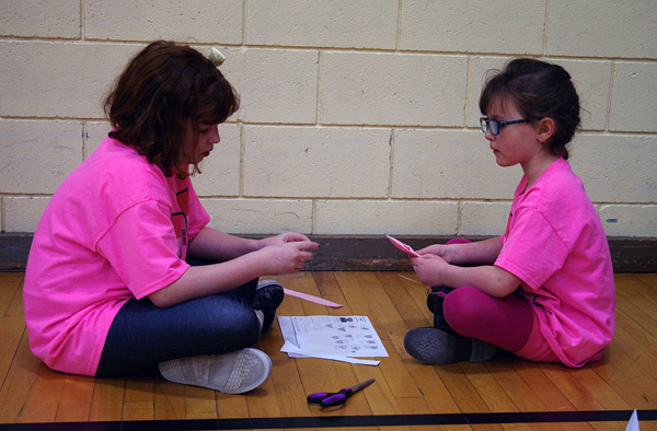Andie Reynolds and Emma Mair work together on their buddy activity in the AHE gym on February 26. Photo by AHE Principal Todd Hicks