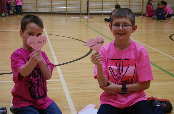 Roean Kurtz and Francesco Morrone show off their origami hearts that they made themselves in the AHE gym . Photo by AHE Principal Todd Hicks
