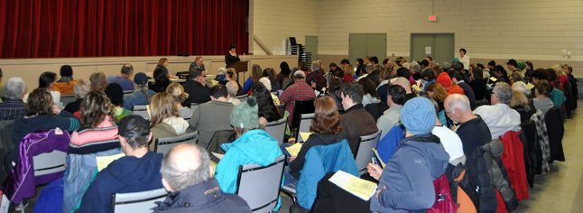 There was quite a crowd at Tuesday evening's Community Initiatives Program gathering. Members of various community groups turned out to hear who was asking for funding from the Columbia Basin Trust. In this photo Catherine Bellerose of the Revelstoke Multicultural Society describes her group's plans for the 2015 Carousel of Nations. David F. Rooney photo