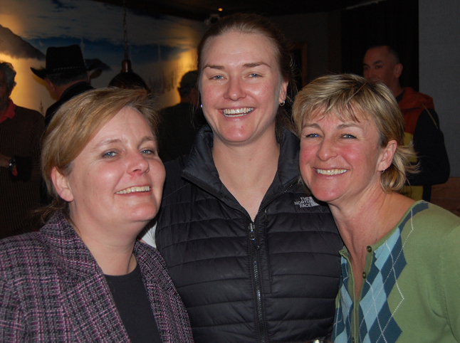 The Powder Springs' Emma Kirkland (left), RMR's Corinna Komdeur and Poppi's Hostel's Poppi Reiner pose for a photo during a Chamber of Commerce event at the Sandman Inn on Thursday.  Chamber members shmoozed and crossed their fingers as the hotel drew for some decent prize packages at Sandman Inns in Kamloops, Kelowna, Penticton and Abbotsford. David F. Rooney photo