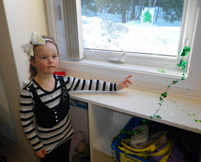 Young Ainsley points to signs of the leprechaun's magical visit. Melinda Brown photo courtesy of CPE Principal Ariel McDowell