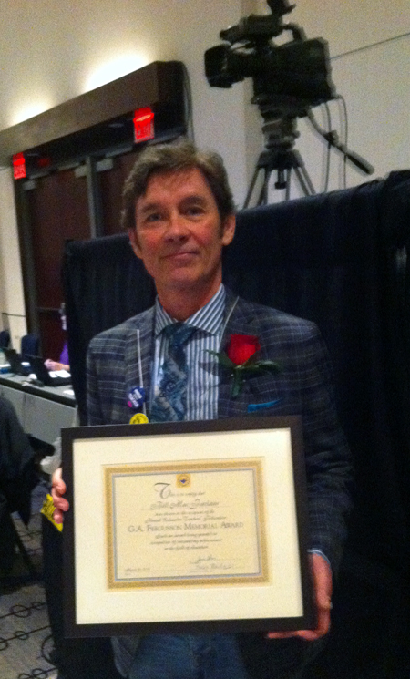 Bill MacFarlane poses with the award he received from his colleagues at the BC Teachers' Federation in Vancouver recently. Photo courtesy of Jennifer Wolney/Revelstoke Teachers Association