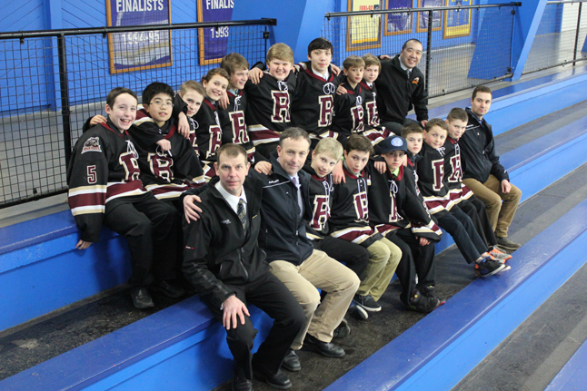 RICHMOND — The kids and coaches of Revelstoke's Pee Wee team are all smiles in this shot taken at the Provincial Championships. Photo courtesy of Linda Chell