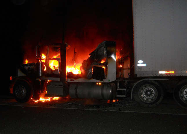 The 29-year-old driver of this truck escaped without injury when his cab caught fire shortly after midnight5 on Friday, March 28, but his 32-year-old passenger wasn't so lucky. The RCMP said he suffered serious burns to the lower portion of his body and was send to Queen Victoria Hospital where he was treated and then sent on to the burn unit at Royal Inland Hospital in Kamloops where he is listed in stable condition. The driver suffered minor burns and cuts duriung the fire, which occurred on the Trans-Canada Highway about 10 kilometres east of town. The Mounties do not know how the fire started but they said in a statement that they think it began in the cab and quickly spread through the vehicle. The fire remains under investigation. Photo courtesy of the Revelstoke RCMP