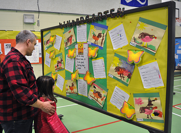 Steve Smith and his daughter Zoe check out the artistic offerings created by CPE's Kindergarten kids. David F. Rooney photo