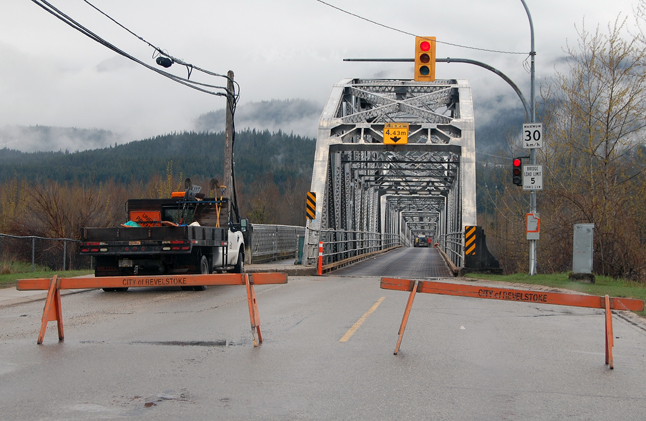 A single-vehicle accident on the Big Eddy bridge has forced the structure's closure for the foreseeable future. A statement from the Revelstoke RCMP said that on Saturday morning, April 26, at about 11:14 a Toyota Tacoma lost control near the centre of the single-lane bridge when it began to fishtail. The vehicle came into contact with both sides of the bridge then over turned, coming to a rest on its driver's side. The bridge metal deck road way was slippery due to the rainfall. David F. Rooney photo