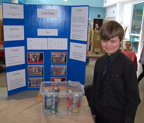 Who knew? Isaac Richardson's science project shows that pop cans filled with sugary drinks and those filled with drinks that are artificially sweetened don't ALL float. Those that are filled with diet drinks float but regular sweetened pops sink. David F. Rooney photo