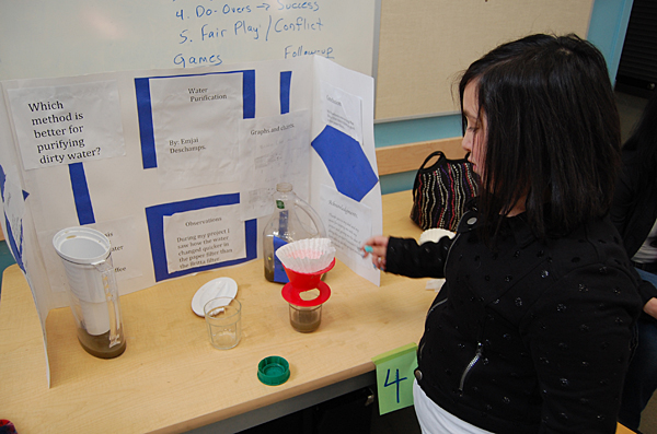 Emjai Deschamps showed the efficacy of different water purification methods. David F. Rooney photo