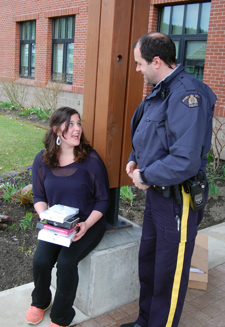 """There's no mistaking the delight and gratitude on Charlotte O'Neil's face as RCMP Const. Seanan Sharpe presented her with a new iPad Air and other technological marvels at the RCMP detachment on Sunday, April 27. Sharpe is the RCMP's Revelstoke cyclist in the annual Cops for Kids cycling event, which raises money to provide children with technologies that can help them out. """"As you know, Cops for Kids is a charitable foundation that helps kids in crisis and their families,"""" he told The Current. """"We have helped numerous families so far in Revelstoke and look forward to helping many more. Here are some current stats,  as of April 24th, we are currently at 76 grant applications for the year and last year we processed 135 so we are way ahead of any other year."""" Sean is currently raising money to help with the Cops for Kids road trip in the late summer. If you'd like to help him out, you can reach him at 250-837-5255. David F. Rooney photo"""