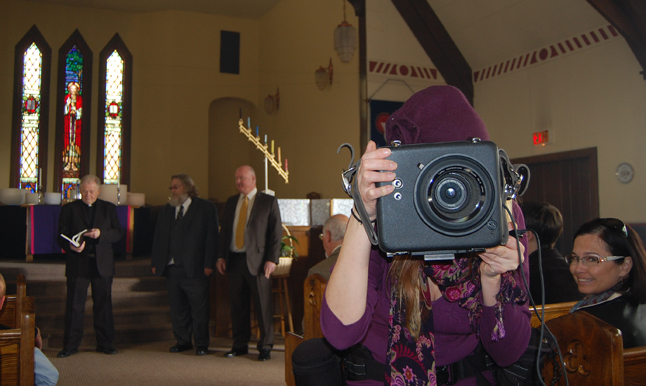 That's local photographer Keri Knapp holding that big, boxy camera... and that's Bonnie Teed with her bright and happy trademark smile behind her. David F. Rooney photo