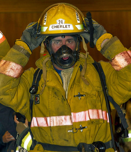 Glen Cherlet settles his helmet as he prepares to race up the stains during the recent Climb the Wall: Stair Climb for Clean Air organized in Vancouver by the BC Lung Association. Photo courtesy of the Revelstoke Fire Rescue Service
