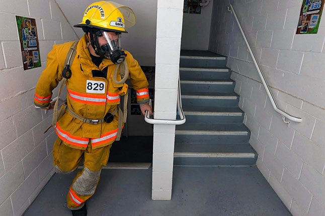 Mike Sihvo rounds a corner in the stairwell at the Sheraton Wall Center. Competitors had to wear their full turn-outs and breathing apparatus which is about 50 lbs of gear. Photo courtesy of the Revelstoke Fire Rescue Service
