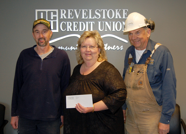 Revelstoke Credit Union CEO Roberta Bobicki poses with Shane Volpatti (left) and Peter Bernacki, the two local men who recently opened a trust account to help electrician Chris Miller and his wife Joanne Lachance. Miller suffered a stroke in January, which has left him with serious physical deficits. He has';t be able to work in months and local resients and friends are being encouraged to help the family by making a donation to the Chris Miller Trust Account No. 334459 at the Revelstoke Credit Union. People have already dropped $1,350 into the account, including the Credit Union's $500 donation on Tuesday morning. David F. Rooney photo