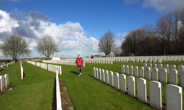 Student Liam Legault pensively strolls through the one of Canada's war cemeteries.  Lisa Cancilla photo