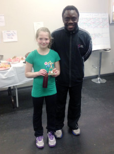 Sophie Dorrius accepts her trophy from Shakiru Matti, Sport Central Head Squash Pro and Tournament Director. Photo courtesy of Kevin Dorrius