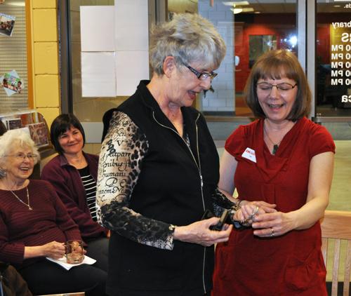 Gerri Farren presents Zoe with a silver watch. David F. Rooney photo