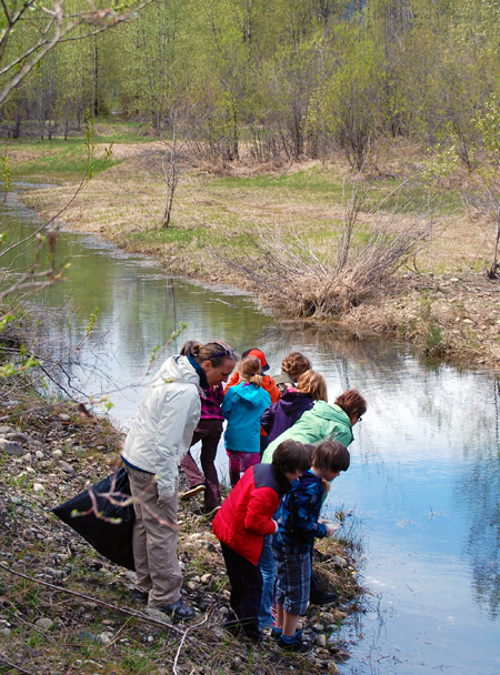 Too early? Too late? The kids scan the waters of a pond along Tadpole Trail for signs of tadpoles. Alas! They could not find any. David F. Rooney photo