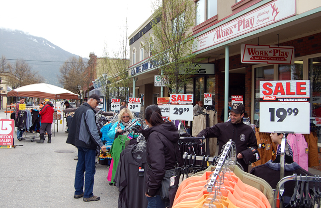 Lots of people looked for bargains down on First Street West. David F. Rooney photo