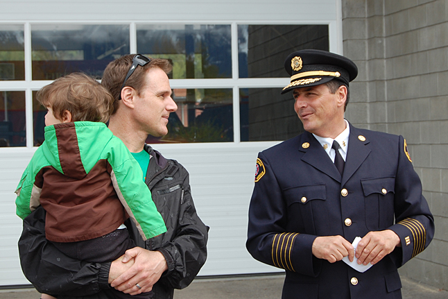 Fire Chief Rob Girard (right) chats with a resident about the new truck. David F. Rooney photo