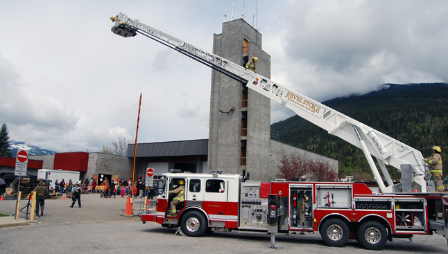 Firesfighter Geoff Wilson (center, descending the ladder) went aloft the take a few photos. David F. Rooney photo