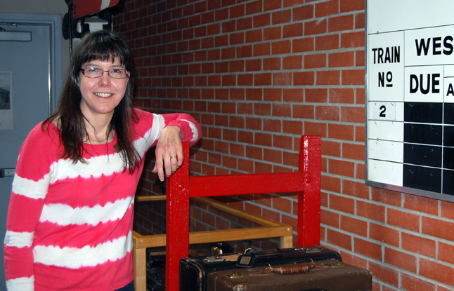 Jennifer Dunkerson poses with one of the baggage carts at the Railway Museum on Saturday, May 10. Jennifer has returned to Revelstoke from Fort Steele to once again take on the role of executive director at the Railway Museum. Welcome back, Jennifer. David F. Rooney photo