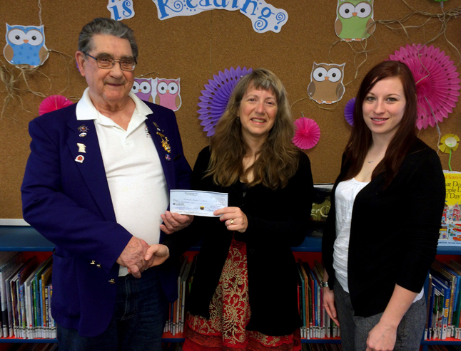 """Clancy Boettger, immediate past-president of the Revelstoke Elks Lodge (left) and Anna Hill (right) lodge secretary, present Assistant Community Librarian Lucie Bergeron (center) with a cheque for $500. Since its establishment in 1960, the Revelstoke Elks Lodge has supported many programs and projects that benefit children in our community, including the library's Summer Reading Club. """"This donation from the Elks gives us the opportunity to provide the children who attend our Summer Reading Club programs with fun, high quality, literacy based programming,"""" Lucie said. """"It also puts us in a position to make sure that all the children coming to our programs have access to great book prizes. We are so grateful to the Elks for supporting us and showing everyone how much they value the library."""" said ACL Lucie Bergeron. George Hopkins photo"""