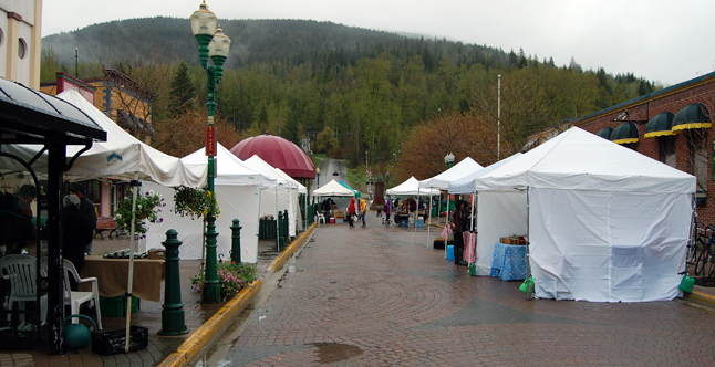 Saturday proved to be a cold and rainy start to the Revelstoke Farm and Craft Market's 2014 summer and fall season. The weather perfectly reflected the popular mood around town of people perturbed by changes to its vendor-scape, specifically the exclusion of Kurt's Sausages. David F. Rooney photo