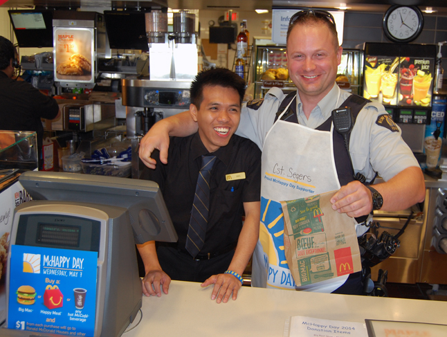 Const. Segers had a little help from his buddy, Yael, at the front counter. David F. Rooney photo